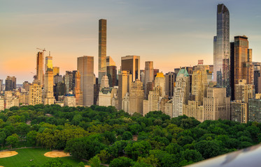 View of Central Park South with New York City skyline in the background