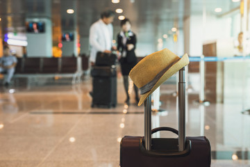 Travel suitcase in airport terminal
