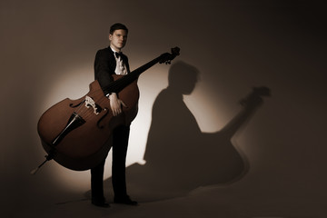 Classical musician studio portrait with double bass