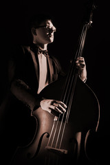 Double bass player playing contrabass