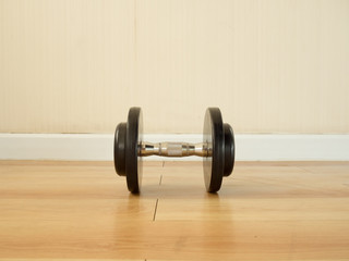 Dumbell left alone on the gym floor.