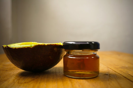 Avocado and honey on wooden floor, healthy concept, organic food concept
