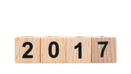 2017 on wooden cubes isolated on white background, new year concept.