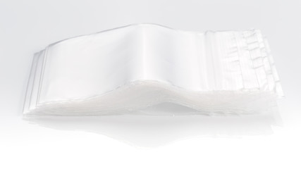empty transparent plastic zip lock bags on white background