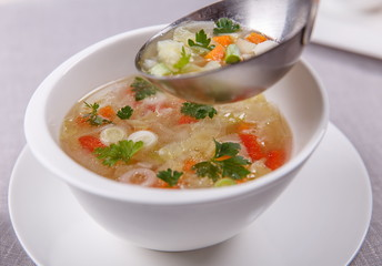 Fresh vegetable soup made of cabbage, carrot, potato, red bell p