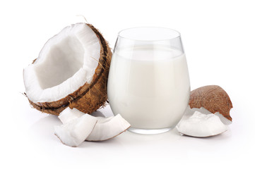 Coconut and a glass of coconut milk isolated on white background.