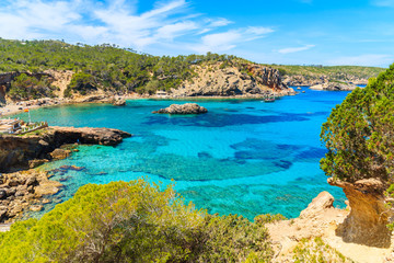 Fototapete - Amazing view of Cala Xarraca bay with azure sea water on northern coast of Ibiza island, Spain