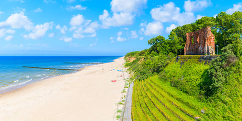 Fototapete - Panoramic view of ruins of old church in Trzesacz village on Baltic Sea beach, Poland