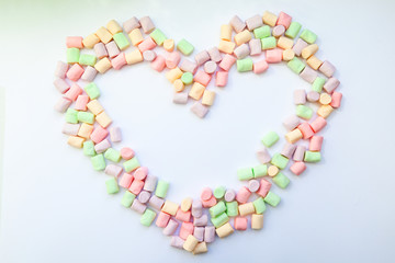 frame heart made of marshmallows . the concept of childhood.