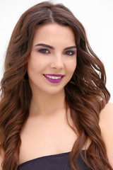 Beautiful young woman with lilac make up on white background