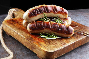 Grilled sausages with sauce ketchup on a wooden table - Home-made Pork Sausages