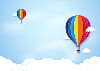 colorful hot air balloons flying on blue sky background. Paper art and craft style design