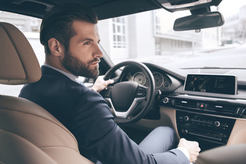 Young business man test drive new car Wall mural