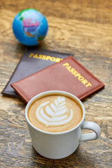 Coffee and passports. Latte cup with flower art.