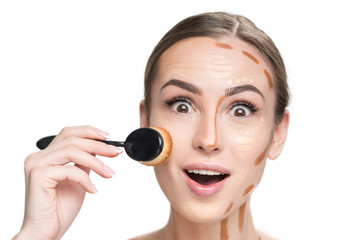 Cheerful lady doing base make-up