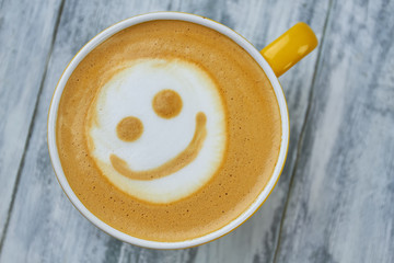 Latte art smiley face. Top view of coffee. Surprising facts about caffeine.
