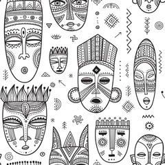 Vector seamless pattern with African ethnic tribal masks decorated with boho ornaments and ritual symbols.