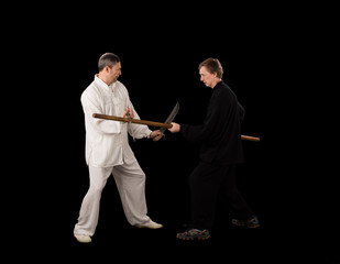 Men fighting martial arts