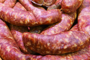 Food plat with delicious salami, pieces of sliced ham, sausage, cooked in a traditional way.