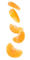 Isolated falling orange segments. Five peeled pieces of orange or tangerine fruit in the air isolated on white background with clipping path