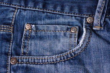 Jeans close-up. Clasps, pocket, seams. Interlacing the fabric with a close-up