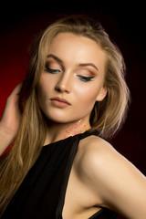 Sensual woman with natural makeup and lush blonde hair