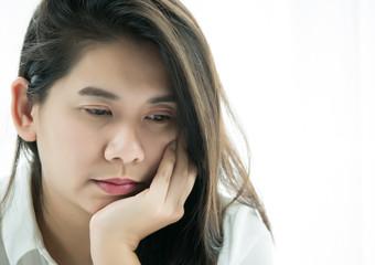 Asian woman with hand on chin her thinking of something.