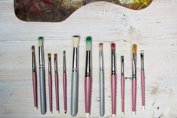 Paint brushes and tip of artists palette