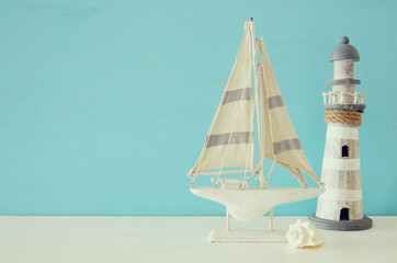 Nautical concept with sea life style objects on wooden table. Top view.