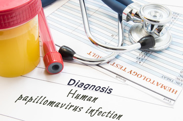 Diagnosis Human papillomavirus infection (HPV). Stethoscope, lab test tube with blood, container with urine and result of blood laboratory analysis are near opinion diagnosis of STDs disease HPV