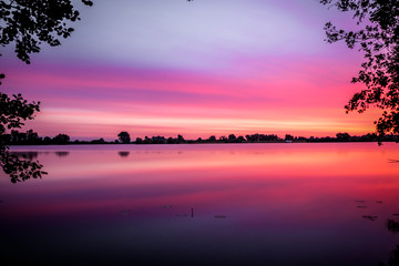 Long exposure colorful sunrise / sunset of the Asseltse plassen in the Netherlands