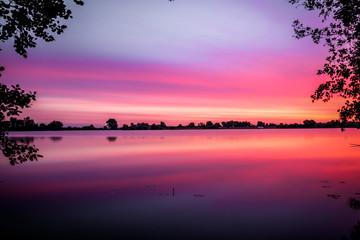 Long exposure colorful sunrise / sunset of the Asseltse plassen in the Netherlands