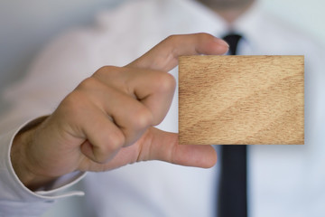 Businessman holding wood board.