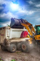 excavator loads gravel