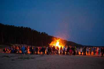 Celebrating the summer solstice on the shore of the Gulf of Riga. Latvia.