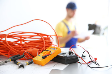 Electric equipment and blurred electrician on background