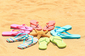 Composition with flip-flops and starfish on sand. Vacation concept