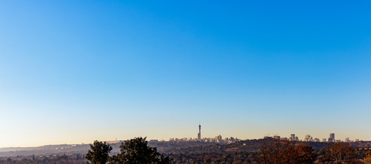 Northcliff view of Johannesburg City Skyline panorama on a winter morning with mist low and clear skies