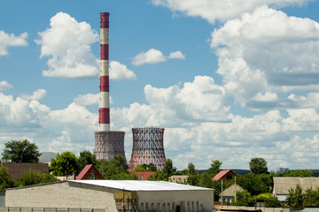 Thermal power plant against blue cloudy sky Wall mural