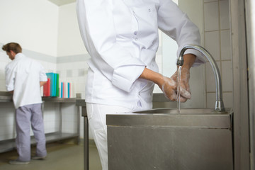 chef washing his hands prior to cook