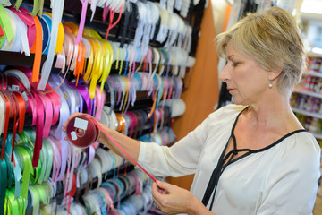lady customer buying ribbon in sewing store