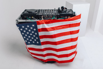 DJ-mixer with American flag on a gray background