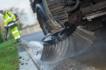 close up from parts of a street cleaning vehicle
