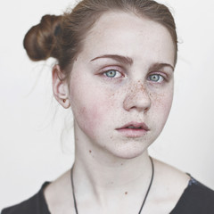 Portrait of a teenage girl with freckles