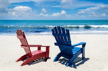 Wall Mural - Red and blue beach chairs near ocean