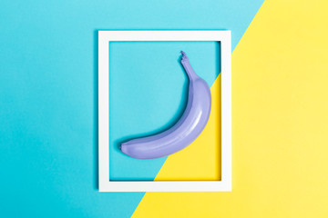 Painted banana on a vibrant background with a picture frame