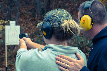 Man Training Female Shooter