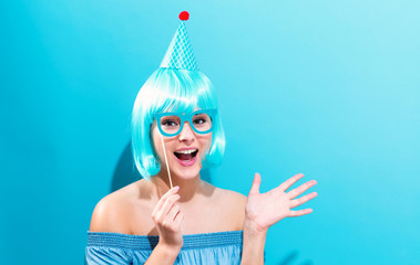Wall Mural - Party theme with a woman in a bright blue wig