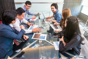 Group Of AsianBusiness people in casual suit working and meeting with happiness action in the modern Office, people business group concept Wall mural