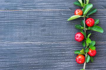 organic brazilian acerola cherry on wooden table